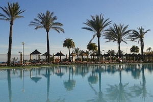 Pool and palm trees, Costa del Sol