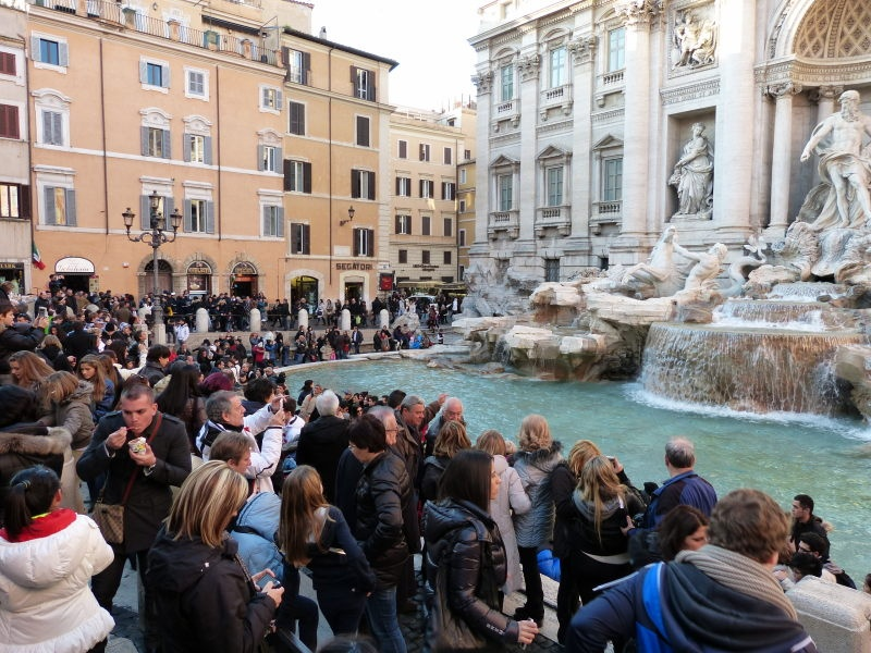 People at the Trevi fountain
